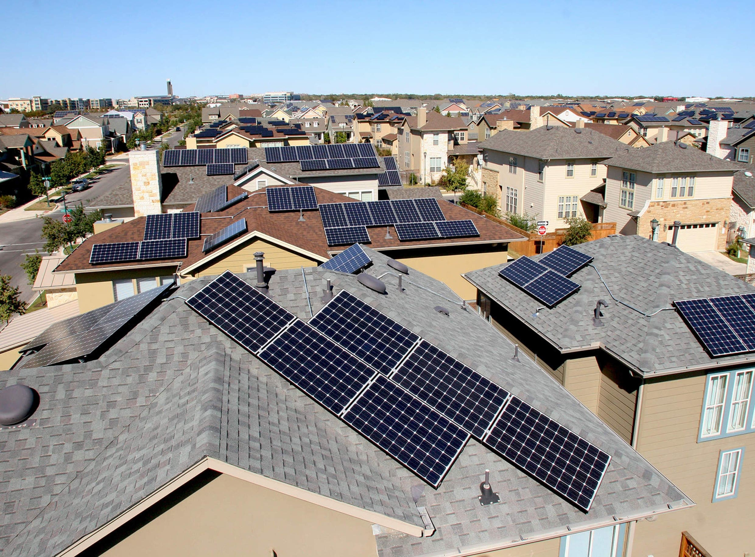 Photo: Private Buildings with PV Panels in the Mueller Community, Austin, Texas, USA, Connected to Electric Drives and Joined to a Utility Distributed Power Grid by the Federal Program SHINES -